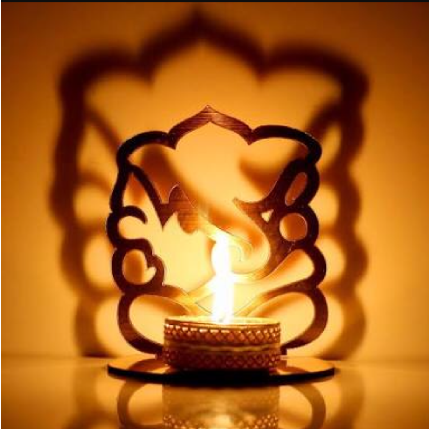 AuraDecor Shadow Ganesha Tealight Holder with a Tealight