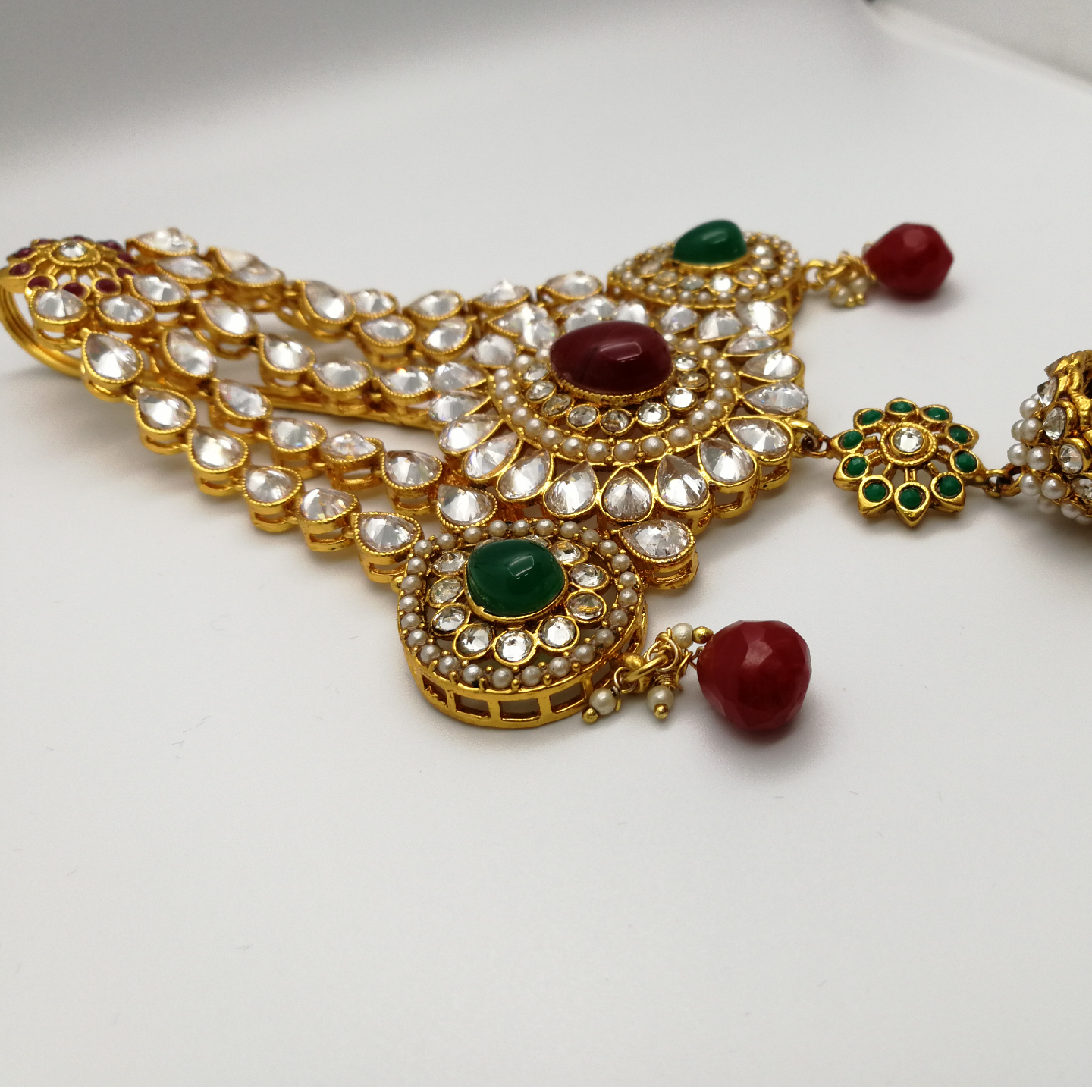 Gold Plated Kundan Passa With Multicolored Stones.