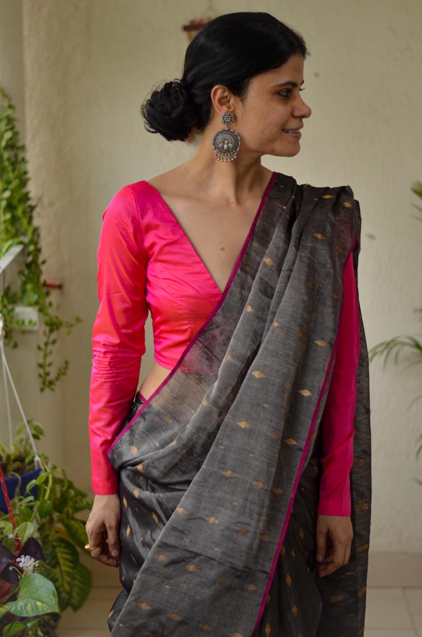Handloom metallic linen saree with gold jari motif.