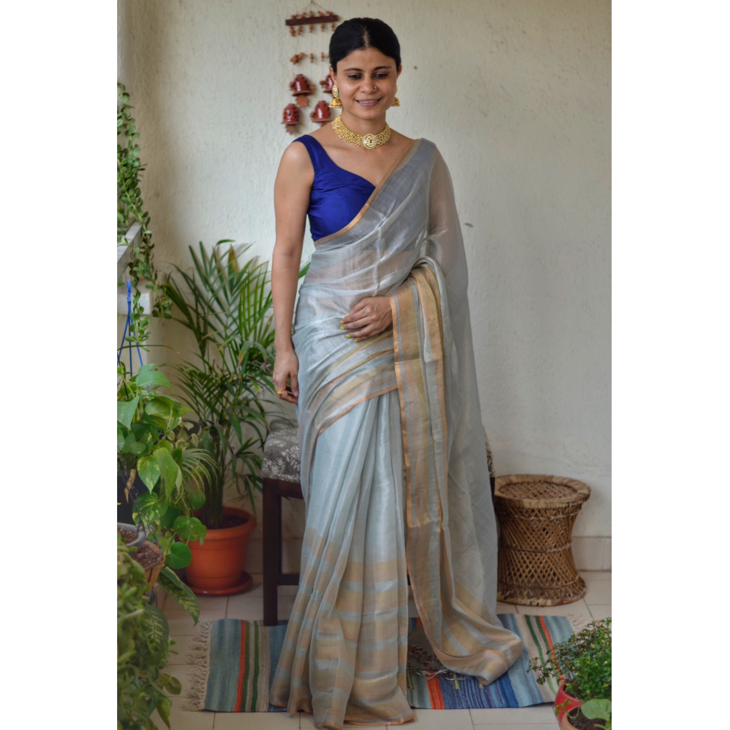 Handwoven mettallc linen saree with stripes in border and anchal
