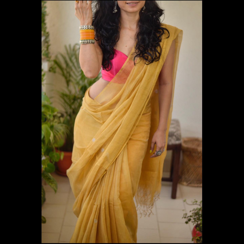 Handwoven mettallc linen saree with jamdani bootis