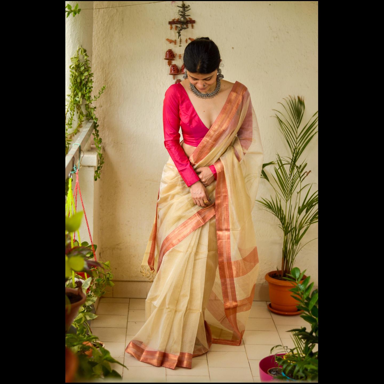 Handloom Maheswari tissue silk saree with woven zari  and resham border.