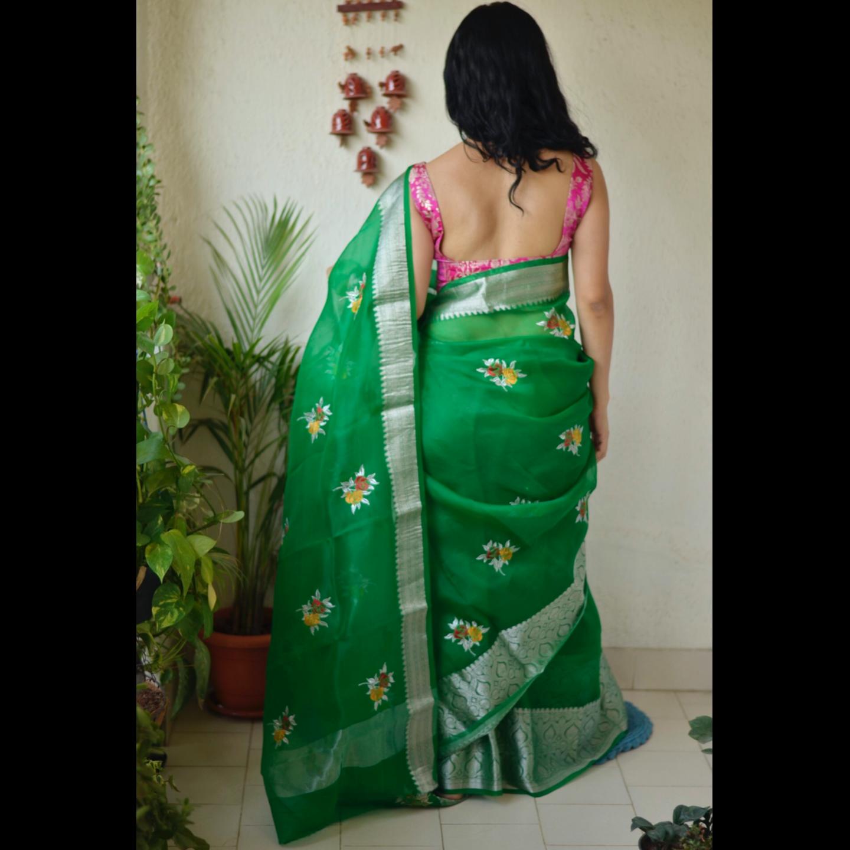 Handwoven organza sheer silk saree with banarasi border and embroidered motifs