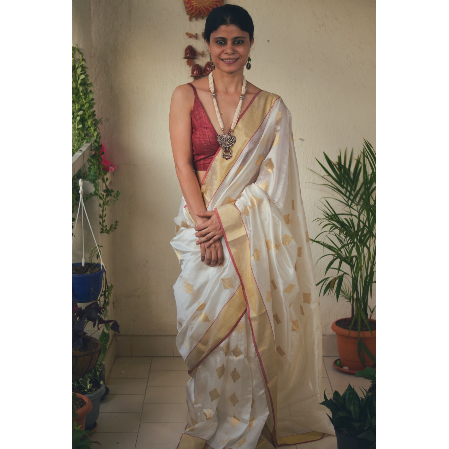 Handwoven chanderi silk saree with gold  border and gold jari motifs