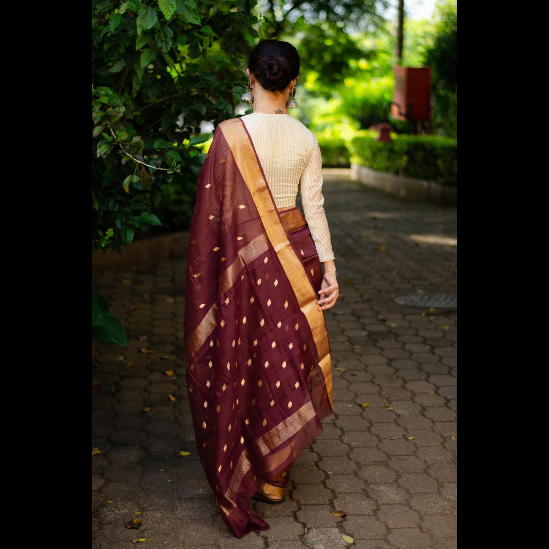 Handloom chanderi silk cotton saree with zari motifs.
