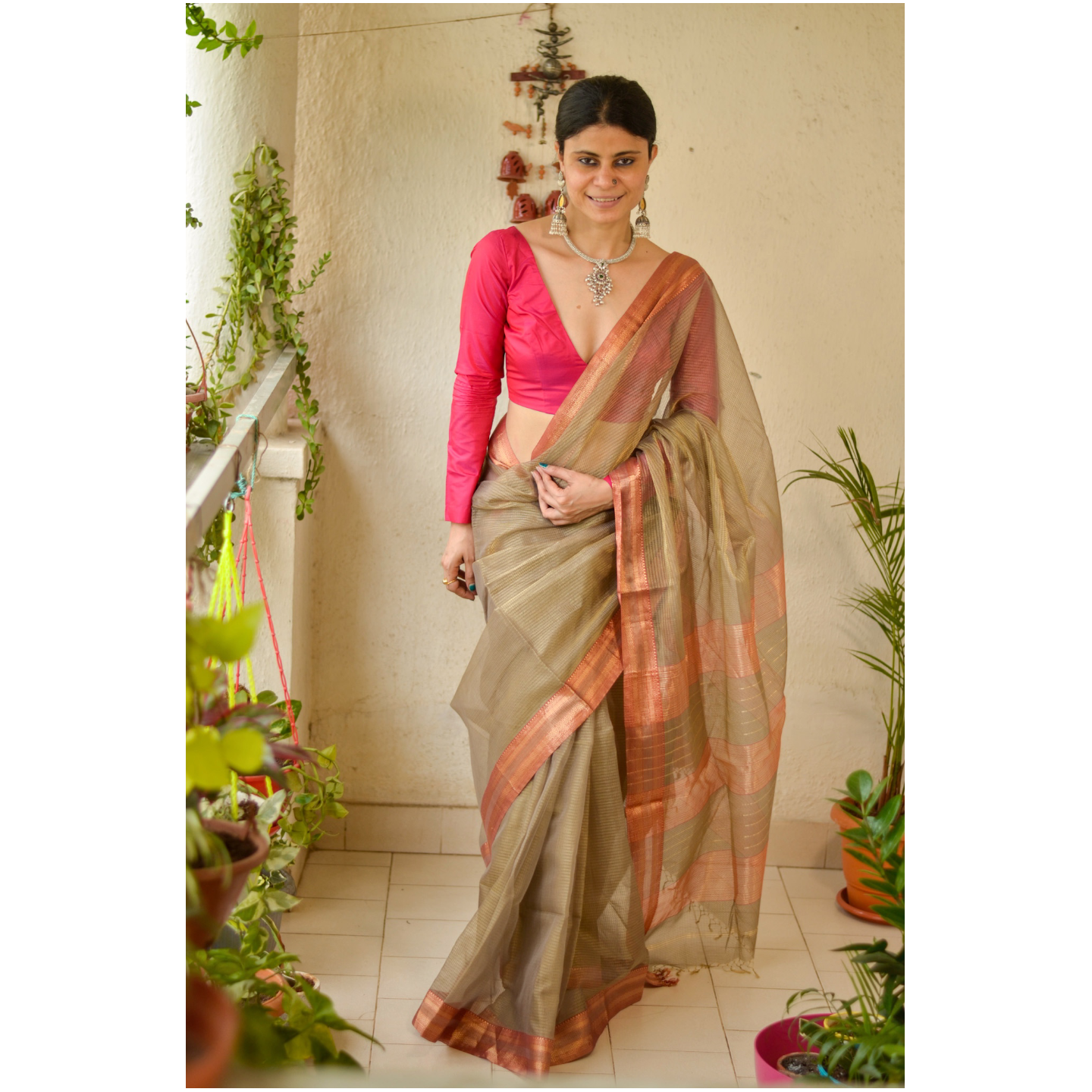 Handloom Maheswari tissue silk saree with woven zari  border.