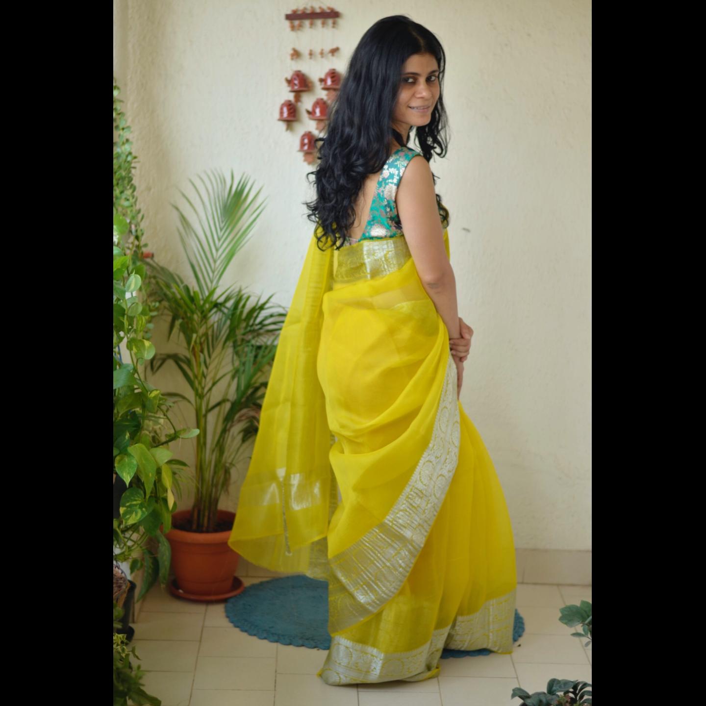 Handwoven organza sheer silk saree with banarasi border.