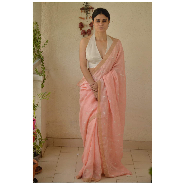 Hand embroidered appliqu handloom  linen by linen saree with goldsilver zari border.