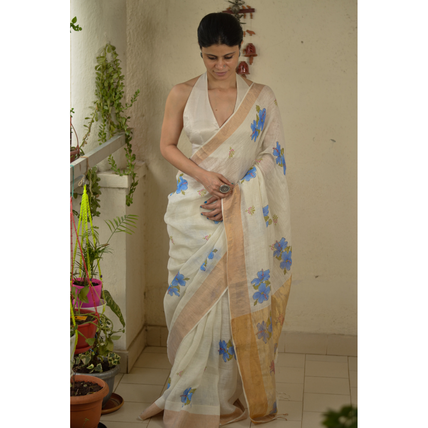 Handblocked printed handloom linen by linen saree with gold/silver zari border.