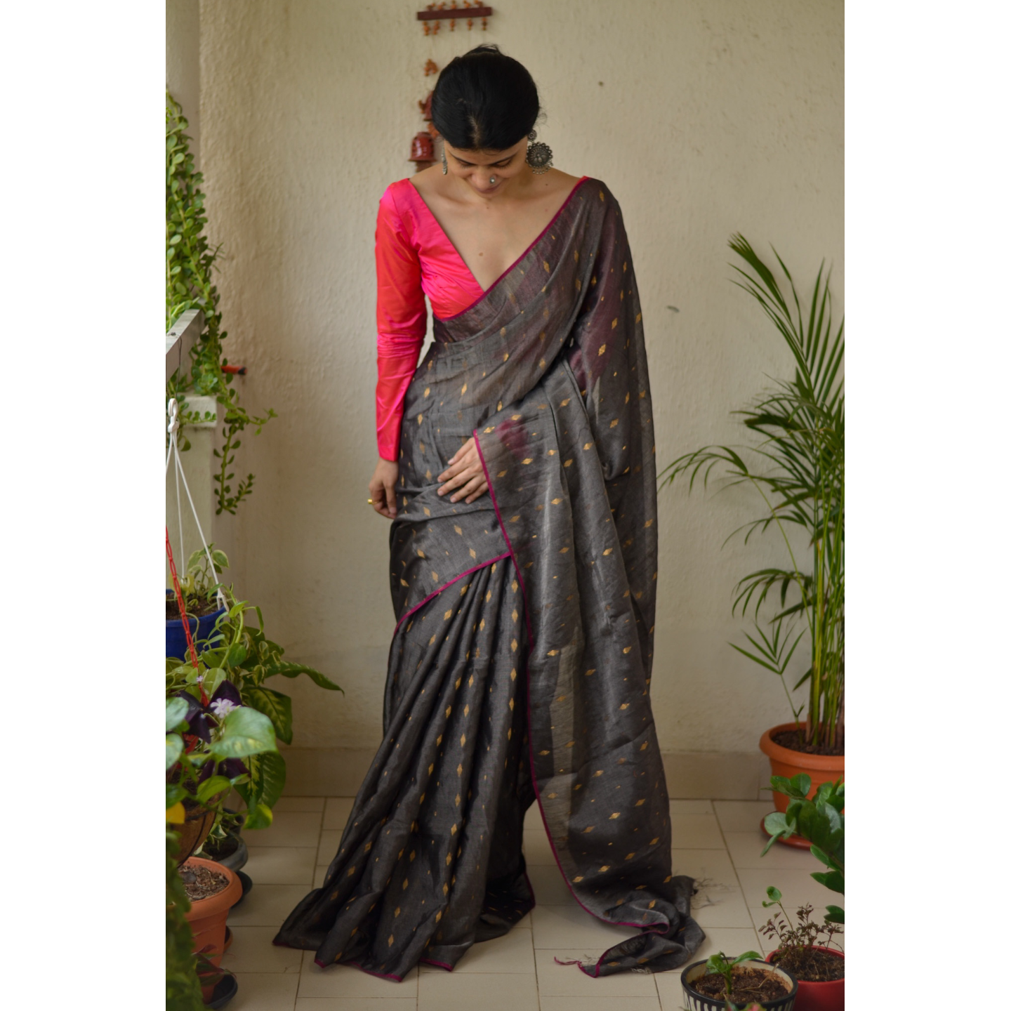 Handloom metallic linen saree with gold jari motif.
