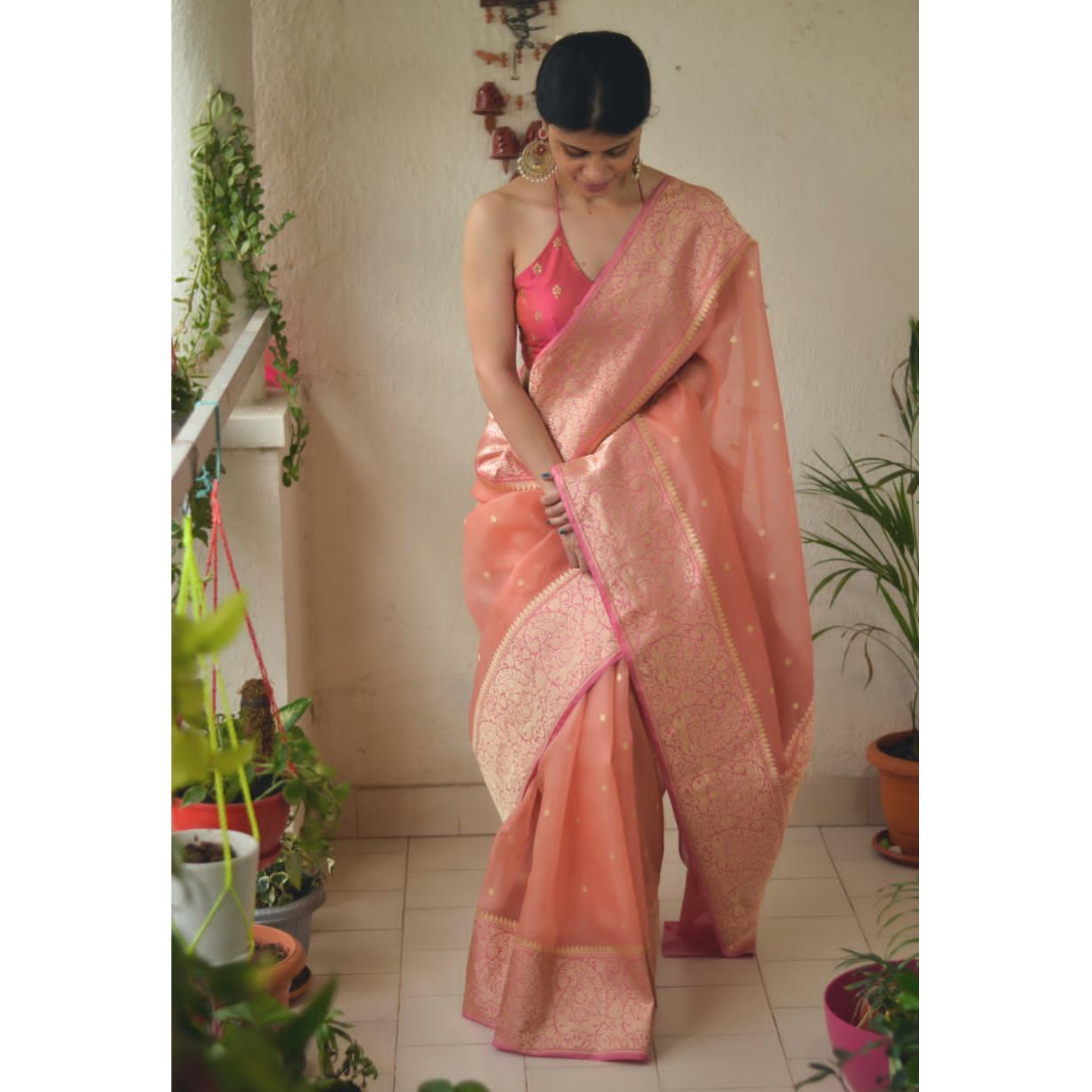 Handloom kadhiyal booti interlock kora silk banarasi saree with banarasi jari motifs.