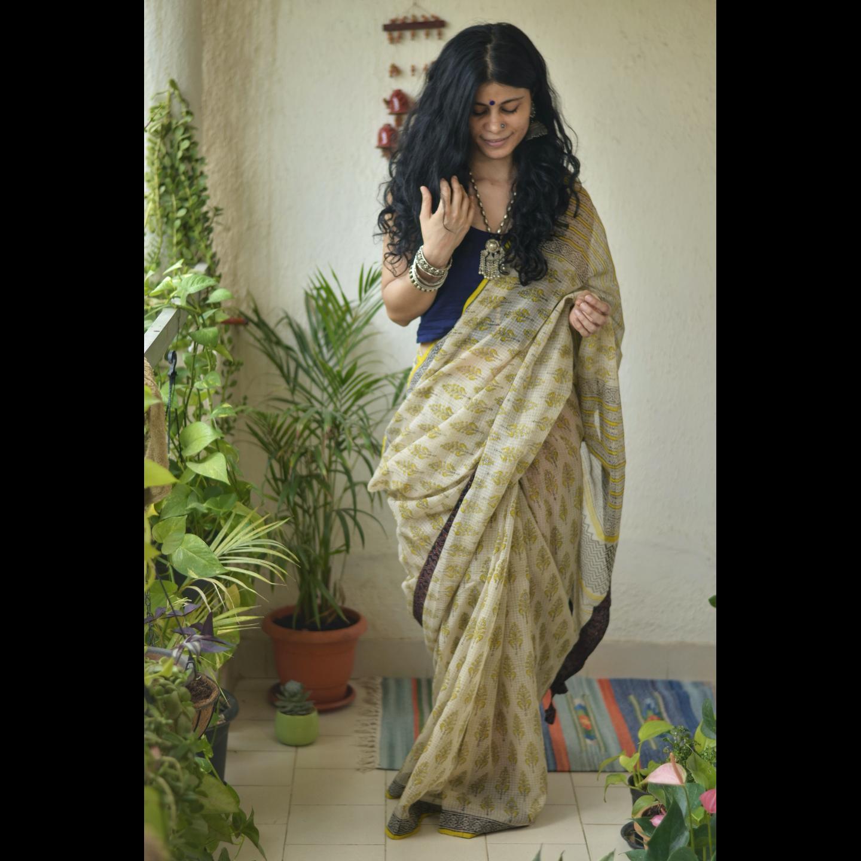 Hand  block printed  natural dyed kota doria saree with Ajrakh patch work border and tassel.