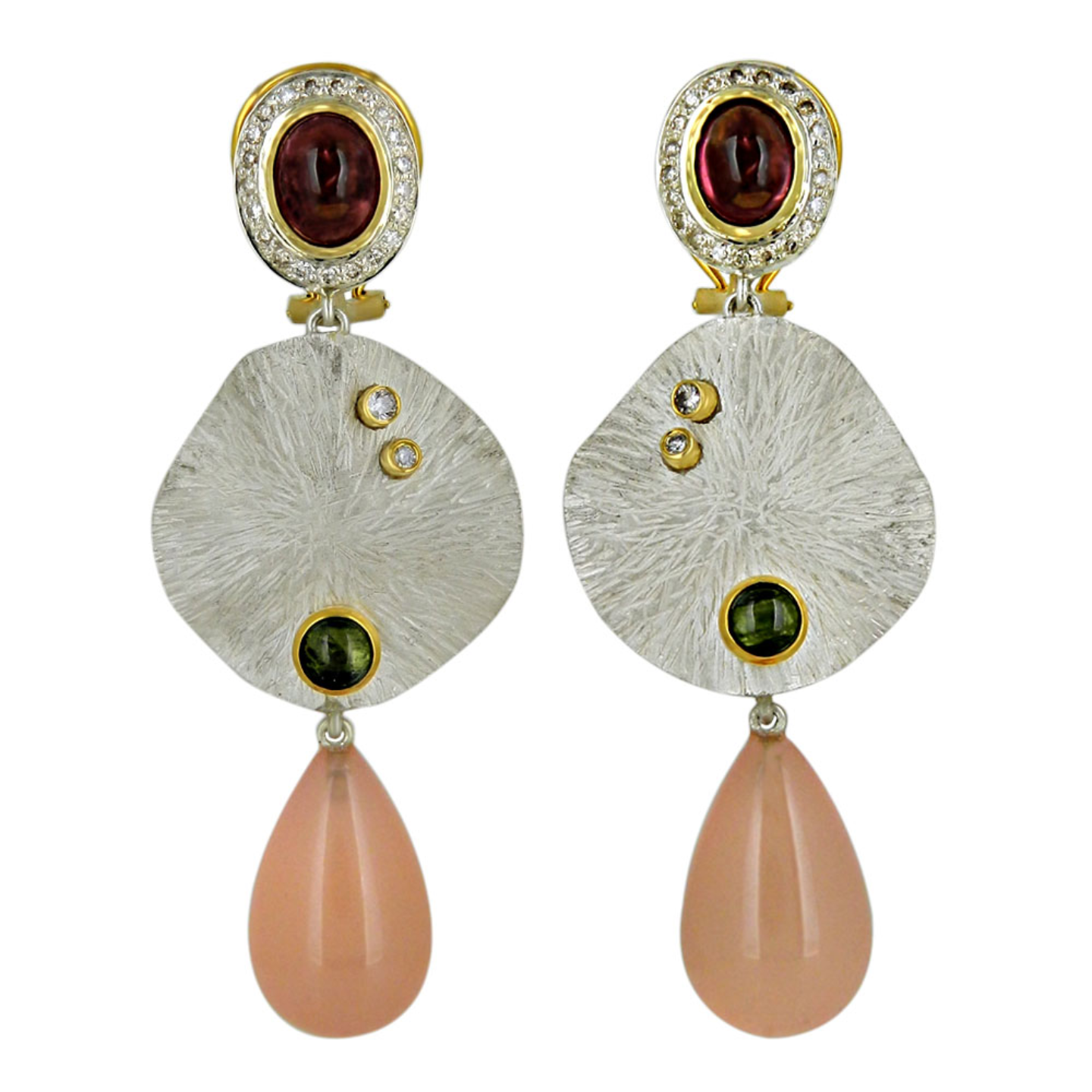 An impressive mix metal textured earrings with gemstones.