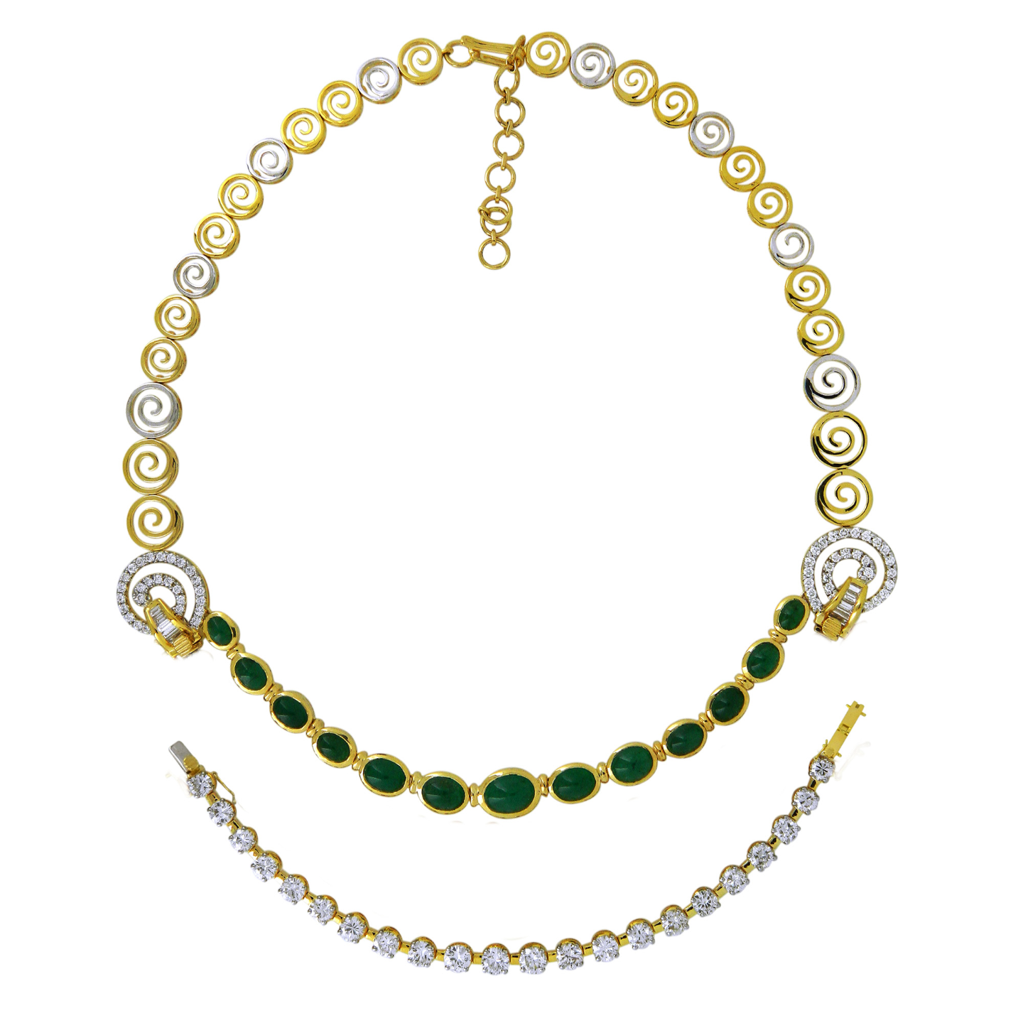A Classic double line necklace with matching earrings in diamonds and emeralds