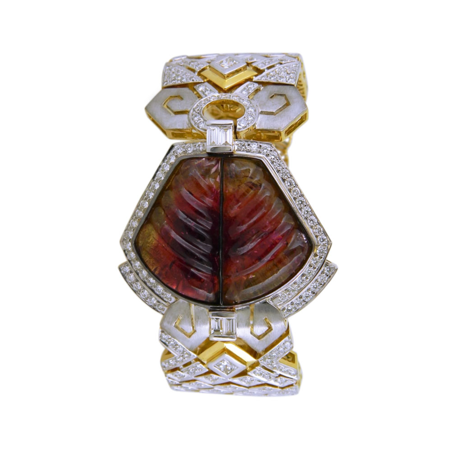 A broad diamond Tourmaline bracelet with geometric inspired filigree, in mix hues of gold