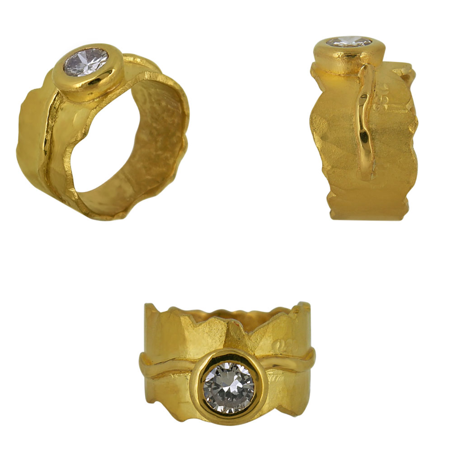 An organic textured bold gold band witha solitaire