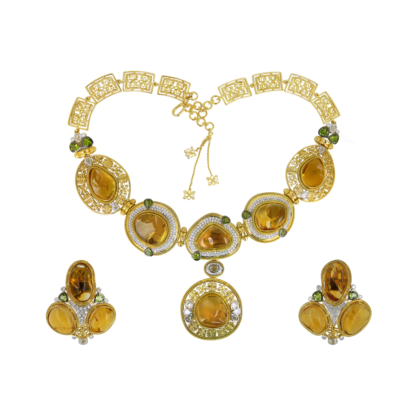 A Grand citrine cabochon yellow gold diamond parure befitting a ceremonius occasion