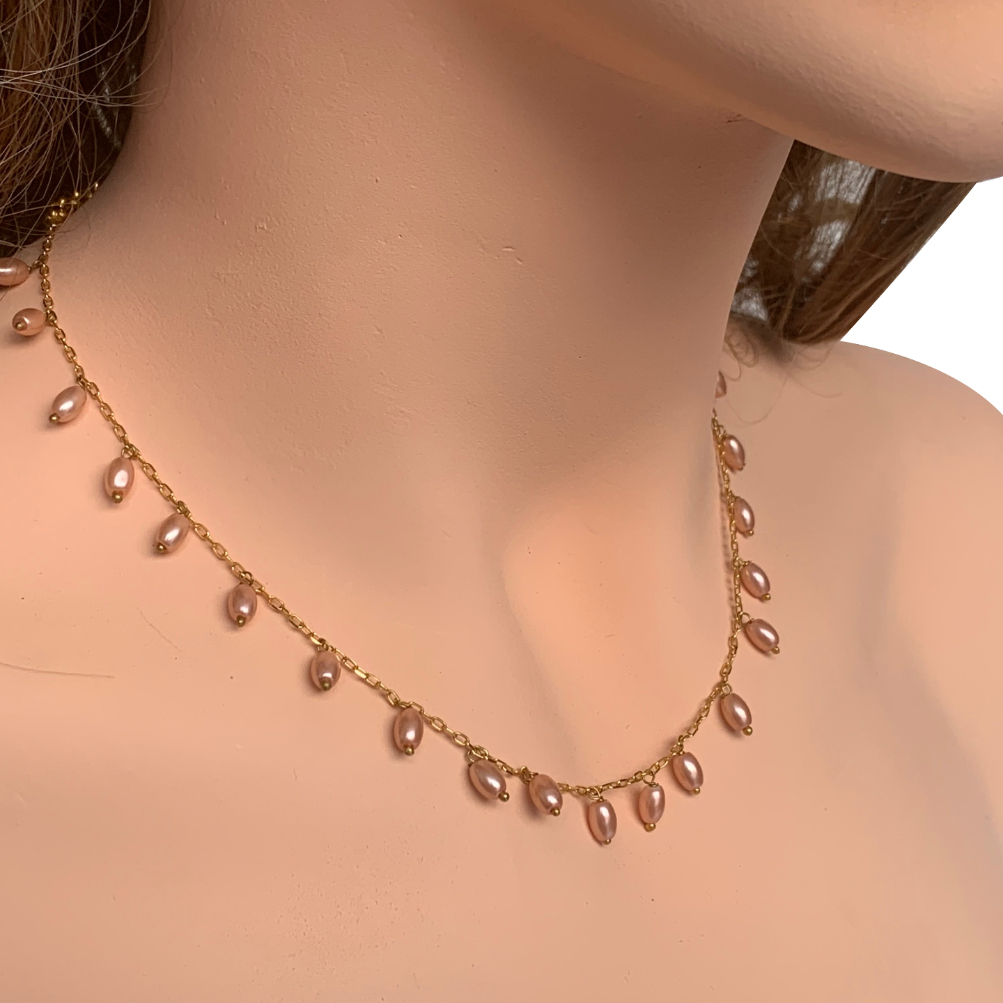 Side view of model wearing RIZZO pink rice pearl chain necklace