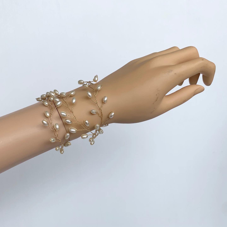 Model wearing VINI modular pearl vine necklace as a cuff bracelet