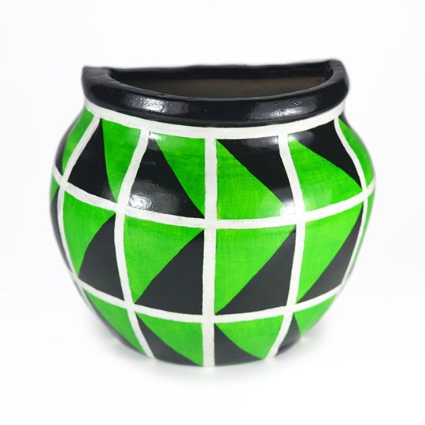 Half earthern pot with green and black coloured